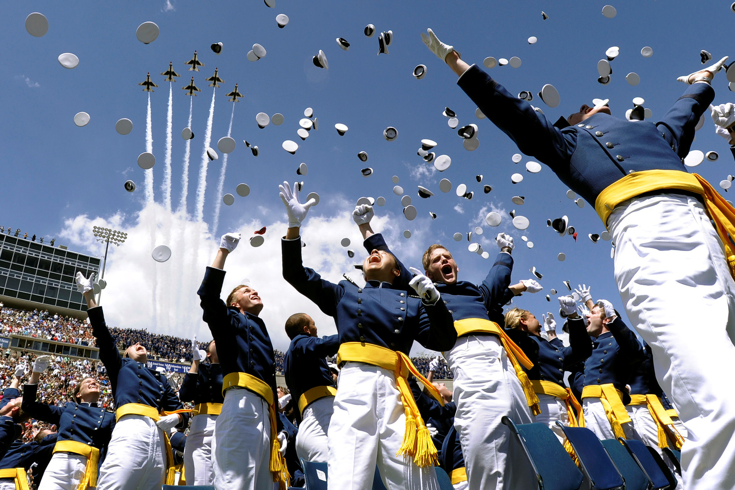 The U.S. Air Force Thunderbirds roar overhead as  the U.S. Air Force Academy Class of 2014 graduate during commencement exercises in Colorado Springs, Colo. May 28, 2014.  A total of 995 cadets  received their commission.  (Air Force photo/ Mike Kaplan)